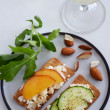 Fresh cheese canape with sliced nectarine and cucumber — Stock Photo #65458801