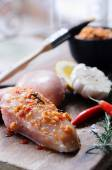 Spice mixture on raw chicken breasts — Stock Photo
