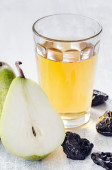 Healthy detox meal of apple juice, pear and prunes  — Stock Photo