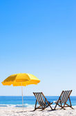 Two sun loungers and an umbrella — Stock Photo