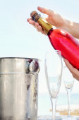 Opening a bottle of champagne  — Stock Photo