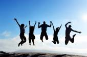 Friends jumping outdoors — Stock Photo