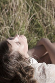 Young woman basking in sun — Stock Photo