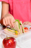 Child removing wholemeal sandwich — Stock Photo