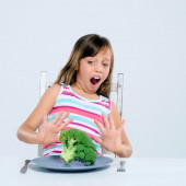 Young kid refuses to eat broccoli  — Stock Photo
