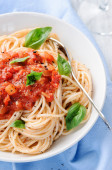 Spaghetti with red tomato sauce and basil garnish  — Stock Photo