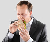 Business man eats lunch — Stock Photo