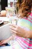 Close up of hand holding champagne glass  — Stock Photo