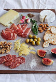 Gourmet platter of cheese and charcuterie  — Stock Photo
