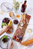 Gourmet cheese and meat platter for a party — Stock Photo