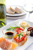 Variety of antipasto on a plate — Stock Photo