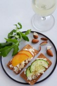 Fresh cheese canape with sliced nectarine and cucumber — Stock Photo