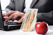 Hardworking businessman with uneaten lunch  — Stock Photo