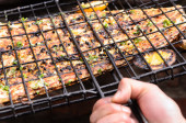 Grilling fish at a barbecue  — Stock Photo