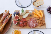 Overhead of gourmet cheese and meat platter — Stock Photo