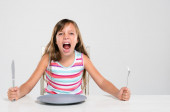 Rude screaming child at dinner  — Stock Photo