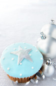 Silver christmas decorations  blue tone cupcake — Stock Photo