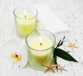 Candle, orcids and towels — Стоковое фото