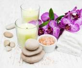 Candles, orcids and towels — Stock Photo
