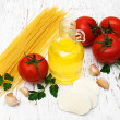 Olive oil, mozzarella cheese, spaghetti, garlic and tomatoes — Stock Photo #67841147