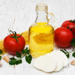 Olive oil, mozzarella cheese, spaghetti, garlic and tomatoes — Stock Photo #68192313