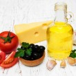 Olive oil, garlic, tomato and cheese — Stock Photo #68588019