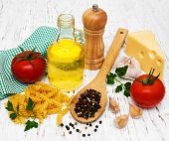 Olive oil,  fusilli pasta, garlic and tomatoes — Stock Photo