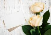 Roses with a card — Stock Photo