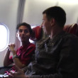 Two Men Talking on the Airplane 2 — Stock Video #76586891