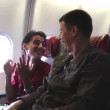 Two Happy Men Talking and Laughing on the Airplane 2 — Stock Video #76593975