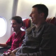 Two Happy Men Talking and Laughing on the Airplane 1 — Stock Video #76594257