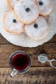 Sugary donuts and hibiscus red tea — Stock Photo