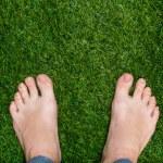 Mens feet standing on grass close up — Stock Photo #65723101