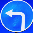 Road sign: turn to the left — Stock Photo #67650501