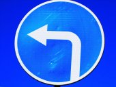 Road sign: turn to the left — Stock Photo