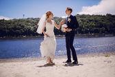 Couple on the lake beach — Stock Photo