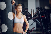 Beautiful blonde doing gym exercises — Stock Photo