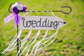 Arrow labeled wedding — Stock Photo