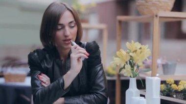 Beautiful brunette enjoys Electronic Cigarette — Stock Video