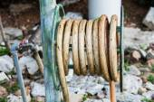 Old water hose on the hanging. — Stock Photo