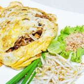 Fried noodle wrapped with eggs, Thai style food , Pad thai — Stock Photo