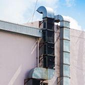 Industrial metal Výfukový otvor zásuvky připojené ke zdi — Stock fotografie