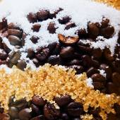 Coffee beans with lumps of sugar — Stock Photo