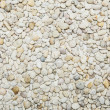 Small naturally polished white rock pebbles background — Stock Photo #64977991