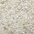 Small naturally polished white rock pebbles background — Stock Photo #64978063