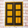 Vintage window on yellow cement wall can be used for background — Stock Photo #64978285
