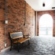 Bench against brick wall — Stock Photo #65125821