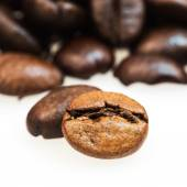 Heap of coffee beans on the table — Stock Photo