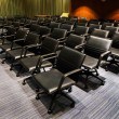 Black chairs in the meeting room — Stock Photo #66204317