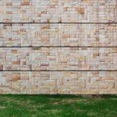 Modern forms of surface rock walls and grass. — Stock Photo
